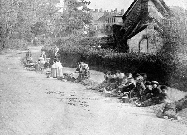 Children sitting at the side of the Road.jpg